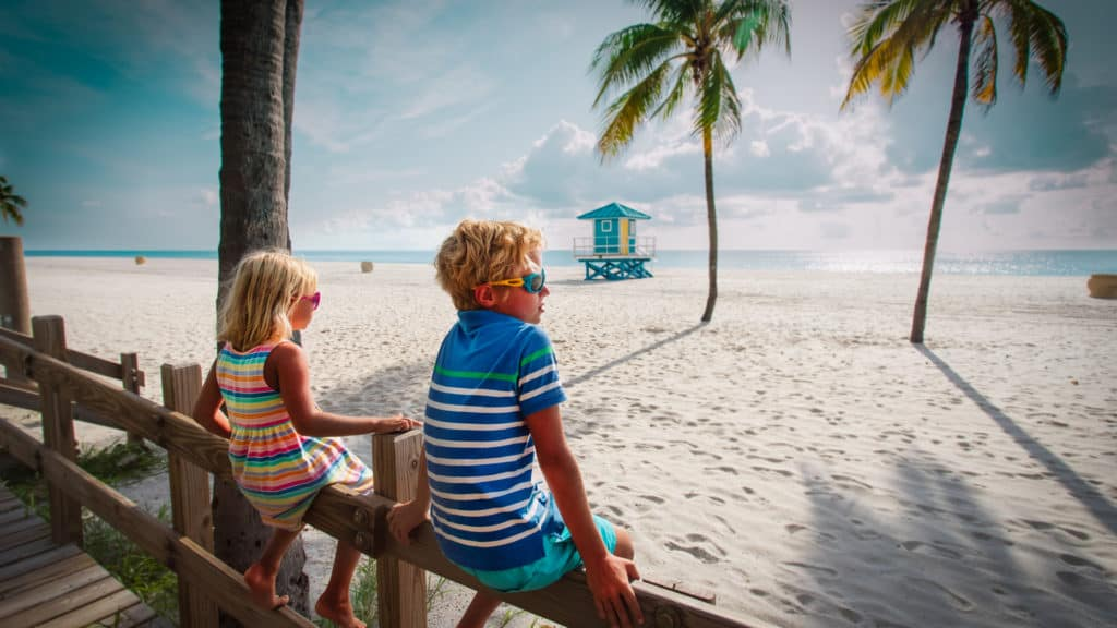 family vacation in florida boy and girl looking at tropical beach