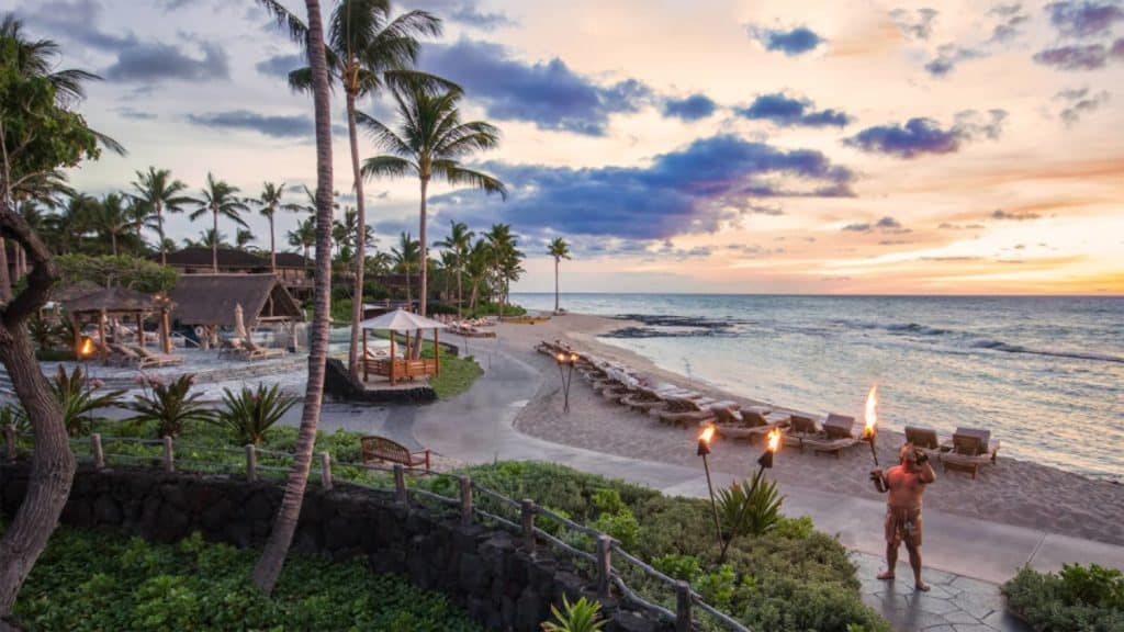 Sunset afternoon at Four Seasons Hualalai Hawaii with beach activities and palm trees