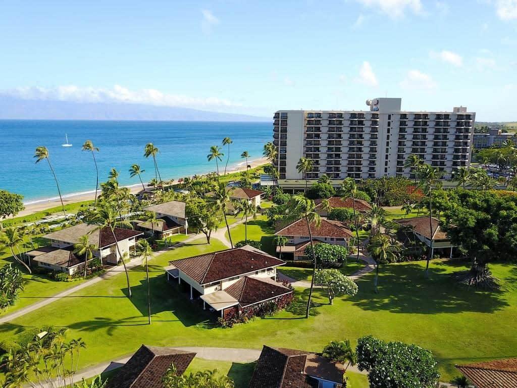 Lush gardens with villas palm trees and the ocean at Royal Lahaina Resort Hawaii