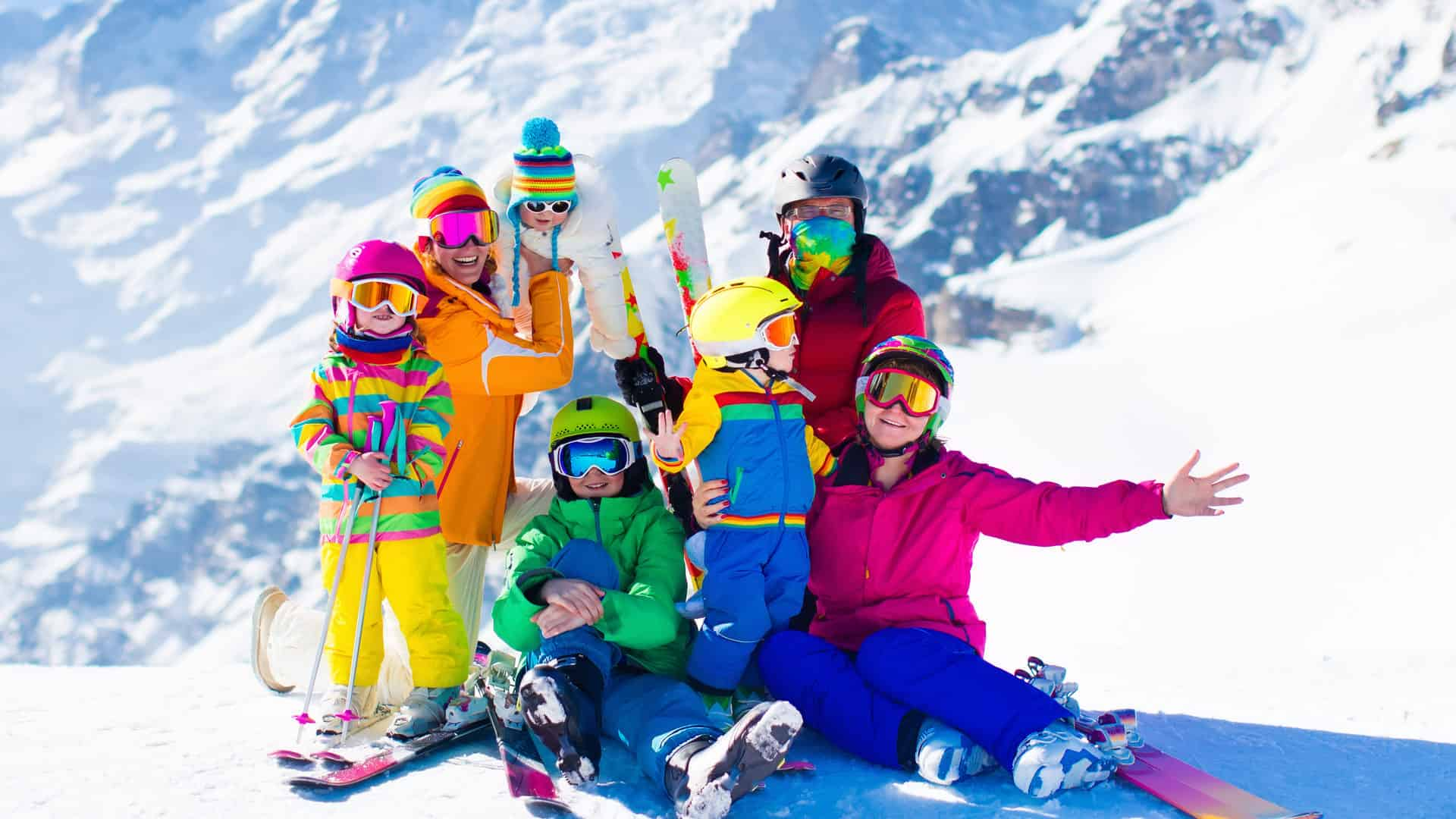 Family skiing in the Swiss Alps in Europe with mountains in the background