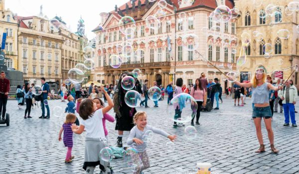 Street artists in Prague Old Town Staromestske Namesti square with bubbles