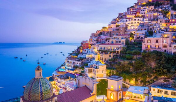 Summer sunset with view of town and seaside of Positano, Amalfi Coast, Campania, Sorrento, Italy