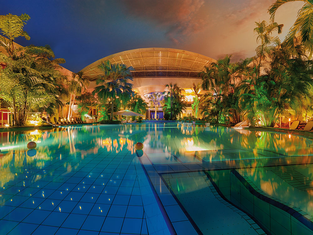 Night view of open air pool at Therme Erding in Garching near Munich, Germany, the largest waterpark in Europe