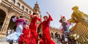 Women dancing flamenco sevillanas at Plaza Espana in Seville Spain