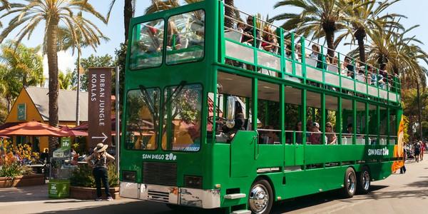 Green open air bus at San Diego Zoo near Balboa Park in California