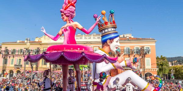 King of the Carnaval moves past the dancing ballerina at Carnaval de Nice, France