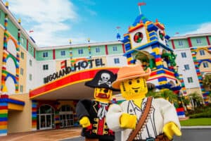 Two large lego figures in front of Legoland Florida Resort hotel