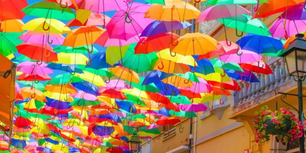 Umbrellas hanging over a street in Portugal for shade