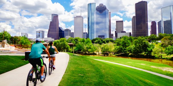 Riding bicycles through downtown Houston, Texas with skyline in background