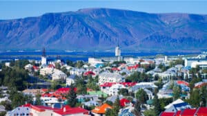 Aerial view of Reykjavik in Iceland with harbor and mountains